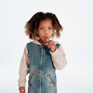 Girl eating a homemade lollipops.