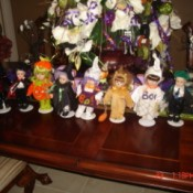 Small dolls in Halloween costumes.