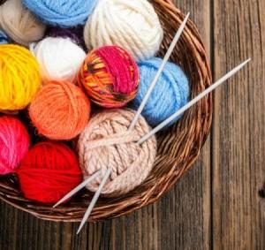 Knitting yarn and needles.