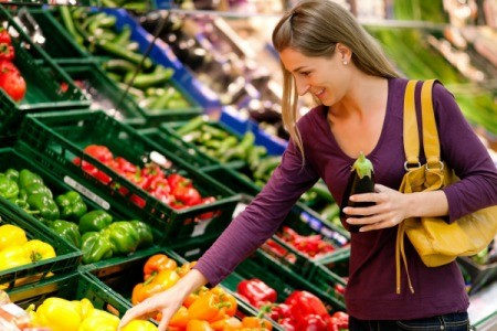 A woman shopping for produce.