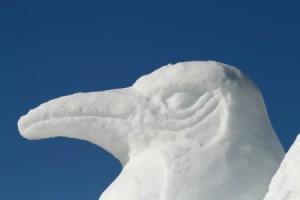 A penguin snow sculpture.