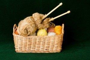 A basket full of knitting supplies.