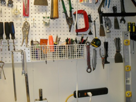 Basket to store tools on tool wall.
