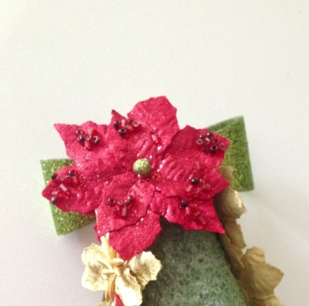 Cover twist tie with poinsettia.