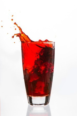 A red drink spilling.