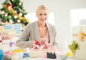 A woman wrapping Christmas gifts.