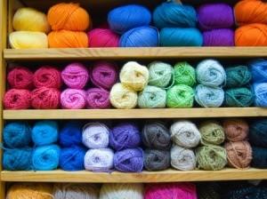 Colorful yarn on a shelf.