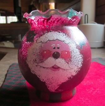 Santa painted on bud vase.