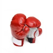 A pair of red boxing gloves.