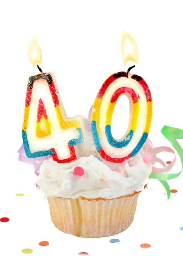 A Cupcake With Candles On It For 40th Birthday