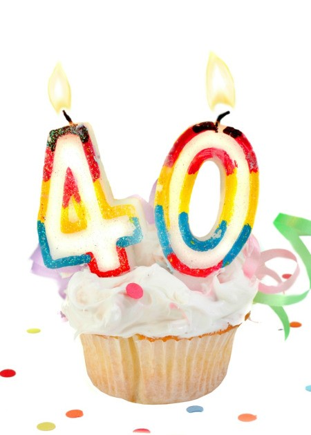 A cupcake with candles on it for a 40th birthday.