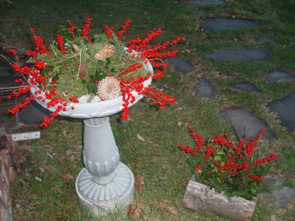 cement birdbath and planter decorated for the season