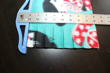 No-Sew Fleece Scarf - cutting the fringe for the scarf