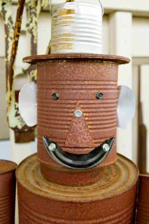 A recycled tin can man.
