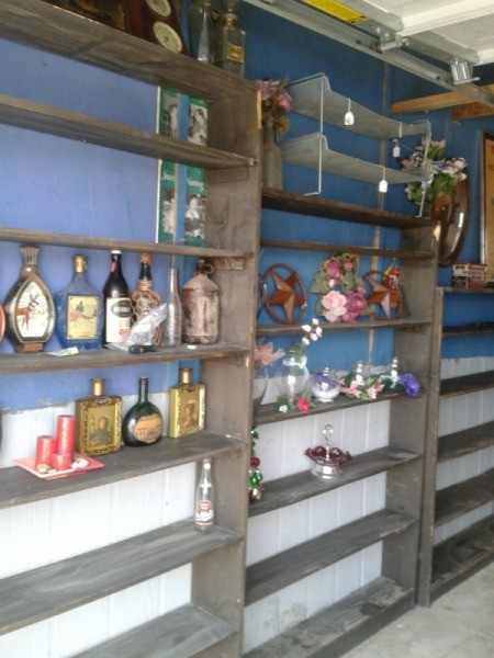Shelves with bottles.