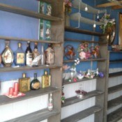 Shelves with bottles.