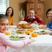 A family eating Thanksgiving dinner.
