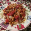 Serving of chickpea curry over rice.