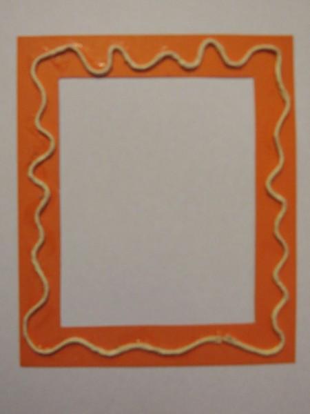 Twine glued to frame.