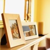 Framed family photos sitting on a shelf.