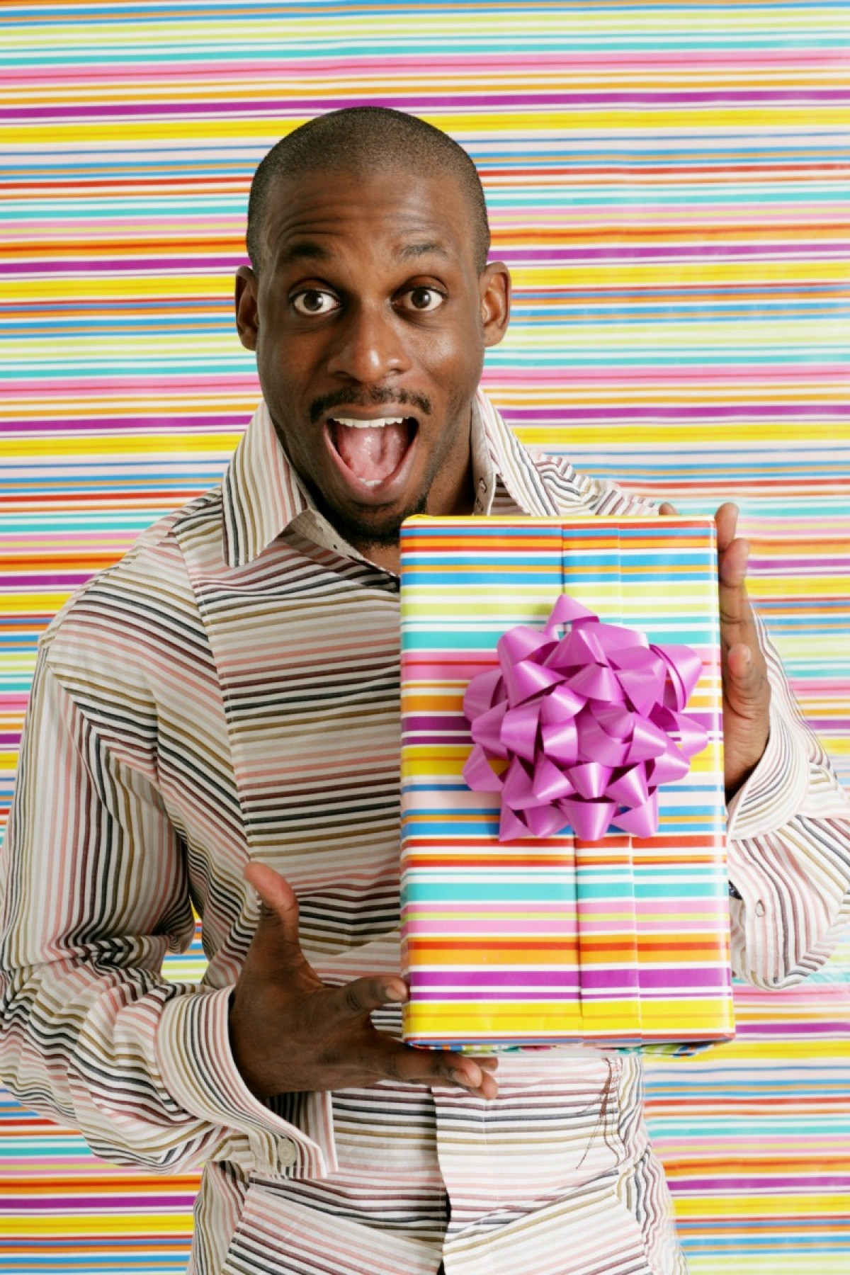 A 30 Year Old Man Holding Gift