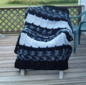 Afghan displayed on deck chair.