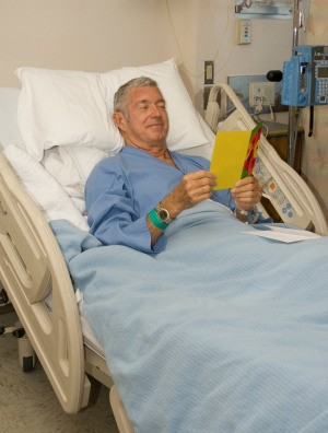 Man in Hospital With Get Well Card