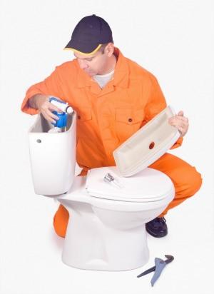 Man Repairing a Toilet