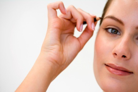 Woman Applying Eyebrow Pencil