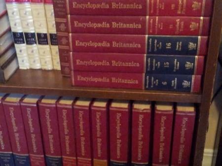 Volumes on bookshelf.
