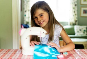 Girl Using Kids Sewing Machine
