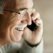 Man Using Telephone
