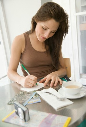Woman Writing Postcard at Home