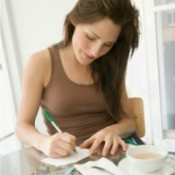 Woman Writing Postcard at Home