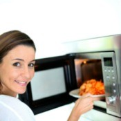 Woman Microwaving Pasta