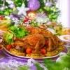 A roast turkey on a Christmas table.