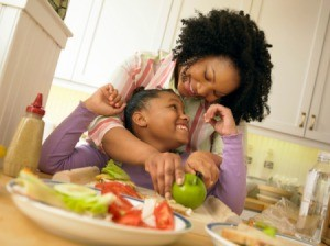 Mom Making Healthy Meal for Daughter
