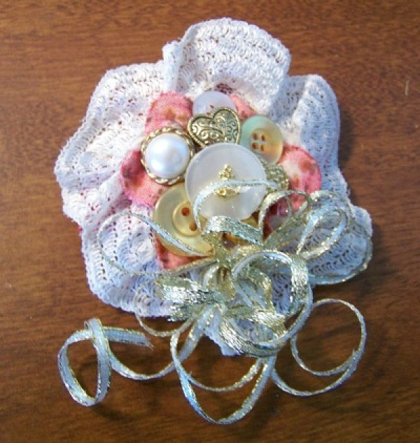 Lacy version of a floral button pin.