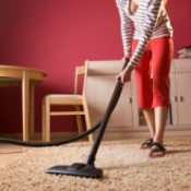 Woman Vacuuming Carpet