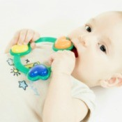 Baby Chewing on Toy