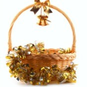 A wicker basket decorated with gold garland and bells.