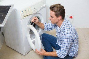 Man Repairing a Washing Machine