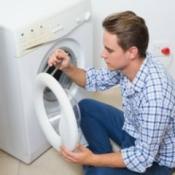 Man Repairing a Washing Machine