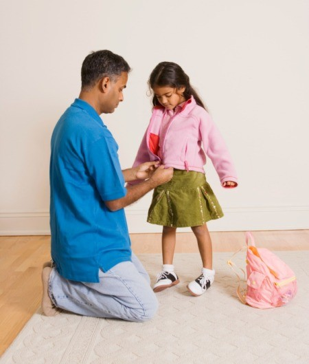 Dad Helping His Daughter get Ready for School