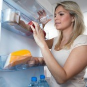 Woman Looking For Substitute Foods in the Fridge