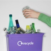 Glass Jar Being Put in Recycling Bin