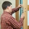 Man Replacing Deadbolt and Door Lock on Door