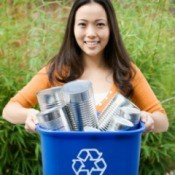 Woman Recycling Aluminum Cans