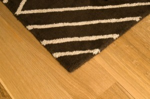 A rug sitting on a wood floor.