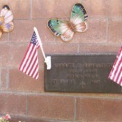 Plaque and butterflies on wall.